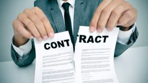 man tearing an employment contract