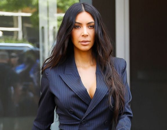 kim kardashian in a black pinstripe suit