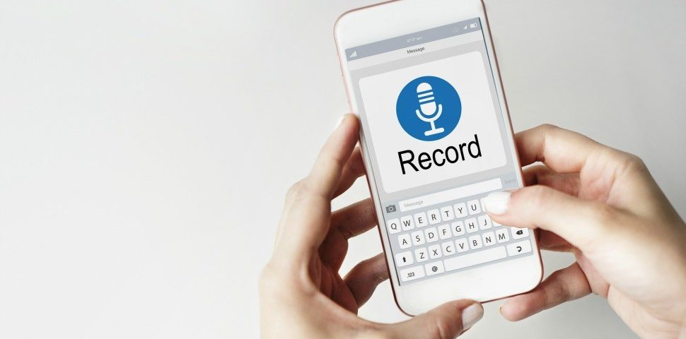 hands holding a smartphone and recording