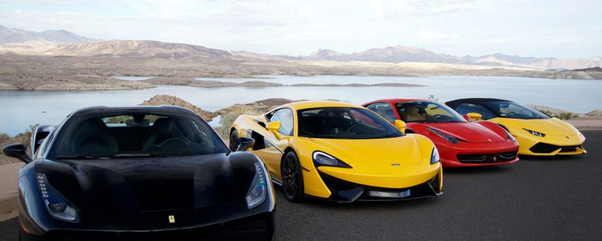 exotic sports cars of all colors parked next to each other