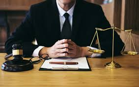 lawyer sitting with notepad and pen